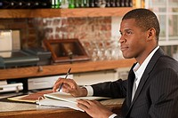 Restaurant owner looking at paperwork