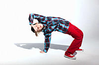 Teenage boy bending backwards