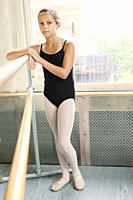 Girl ballerina at barre