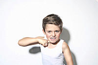 Boy 8_9 standing against white background, gesturing