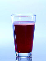 Glass of black currant juice, close_up