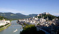 Austria, Salzburg, View of old town with mountains in background