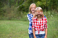 Girl covering friend´s eyes