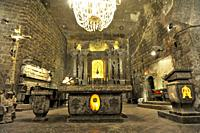 Chapel and altar where everyhting including the chandlier is made of salt in the Wieliczka Salt Mine (a UNESCO World Heritage site), Krakow, Poland