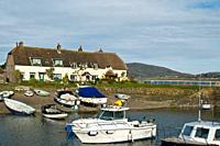 PORLOCK WEIR SOMERSET Thatched cottages boats in Porlock Weir Harbour