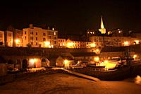 Tenby Harbour illuminated at night, Tenby, Pembrokeshire, Wales