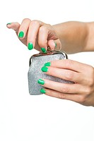 Close_up of woman's hands opening purse