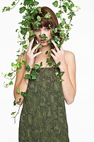 Woman with ivy covering her face