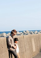 Father and son on breakwater