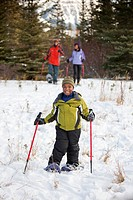 A Boy Skiing With His Parents, Lake Louise, Alberta, Canada