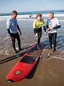 On the beach in Pismo Beach, California, during the Surf Clinic sponsored by AmpSurf, Julie Jo Caruthers, who lost one leg to Chondrosarcoma, a cartil...