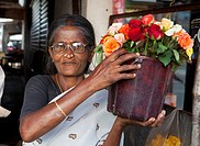 A Woman Holding A Pot Of Flowers, Sathyamangalam, Tamil Nadu, India