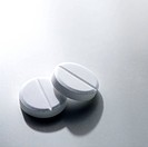 Two plain white pills