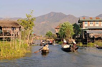 Boats in the main channel of the Intha village built on stilts, Inle Lake, Shan State, Burma, Myanmar, Asia