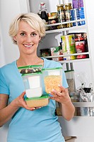 Woman with several food storage boxes
