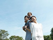 Family who watches distance in park