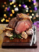 Sliced roast beef with garlic for Christmas dinner