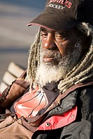 Portrait of a mature homeless African American man at The Washington Street Public Boat Landing - Seattle, Washington