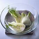 Raw fennel in a bowl of water