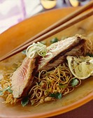 Grilled tuna steaks on Asian noodles with a ginger and soy sauce