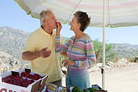 Mature couple at rural fruit stand