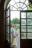Mature couple by french doors (thumbnail)