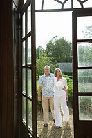 Mature couple by french doors