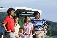 Men And Women With Golf Cart