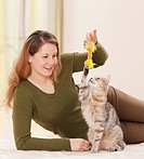 woman and domestic cat _ playing