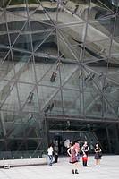 People standing outside Opera House, Zhujiang New Town area, Guangzhou, Guangdong, China