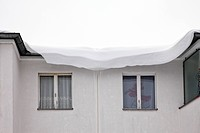 Snow on the roof of a house built in the sixties