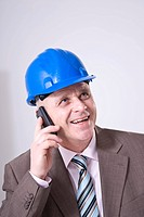 Man with a hard hat on the phone