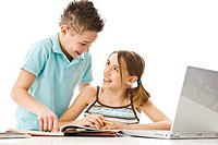 Boy and girl learning together with a computer