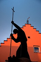 Silhouette of a religious statue at Fussen in the Romantic road, Bavaria, Germany