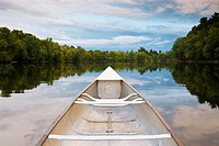 Canoe on the water of Stillwater River, Orono