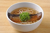 Herring on soba noodle soup
