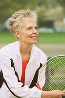 White middle_aged woman playing tennis