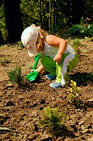 little gardener with children shovel. nature