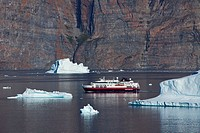 Cruise ship among icebergs in the Uummannaq fjord, North_Greenland, Greenland
