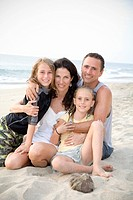 Family hugging on the beach