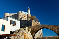 Medieval bridge and lighthouse in the Castle of Santa Ana, Castro Urdiales, Cantabrian Sea, Cantabria, Spain