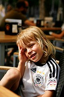 Blond boy, 3, wearing a Germany shirt from the 2006 World Cup