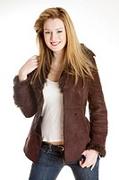 portrait of standing young woman wearing jacket