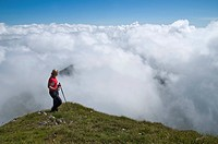 Hiker above the clouds, Styria, Austria, Europe