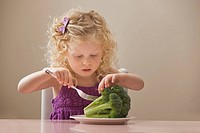 USA, Utah, Lehi, girl 2_3 eating broccoli