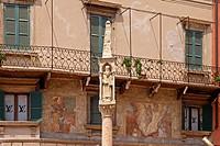 Verona, old facade with a statue, Veneto, Italy