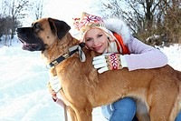 young woman walking the dog in winter landscape