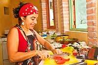 woman preparing food in kitchen