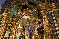 An ornate gold embossed statue of the Virgin Mary and baby Jesus.