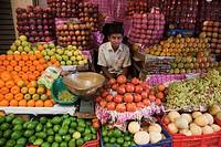 India, Karnataka, Mysore, man selling fruits at the Devaraja Market
